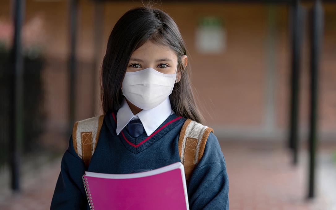 Catholic school student wearing mask