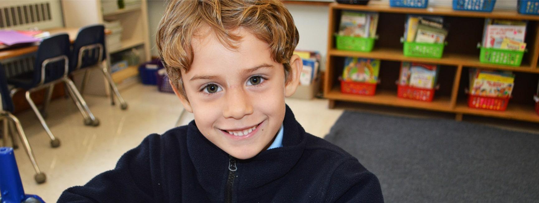 Catholic school student smiling at camera
