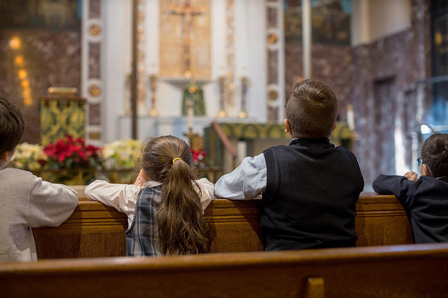 students praying in church