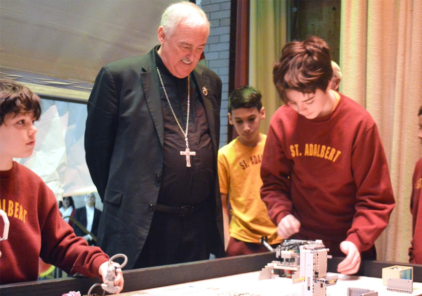 priest observing robotics competition